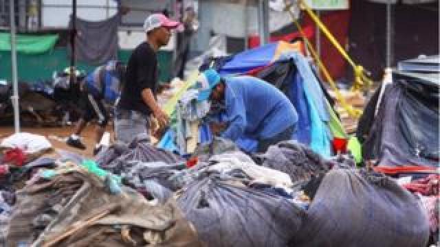 People pick their belongings at the Benito Juarez shelter in Tijuana, Baja California, Mexico, 1 December 2018.