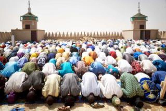 Muslims praying at a new mosque in Djenne, Mali - Friday 28 February 2020