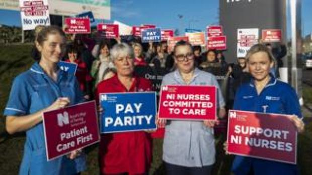 Nurses on strike holding placards outside the Ulster Hospital