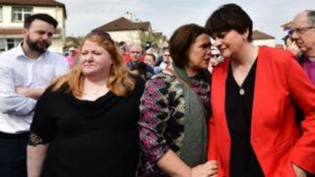SDLP leader Colum Eastwood Alliance Party leader Naomi Long, Sinn Féin president Mary Lou McDonald and Democratic Unionist Party leader Arlene Foster at the vigil in Londonderry