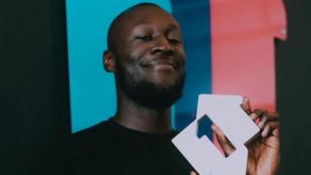Stormzy with number one sign