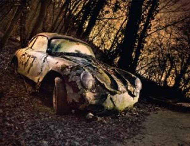 Cars: An abandoned car in a forest