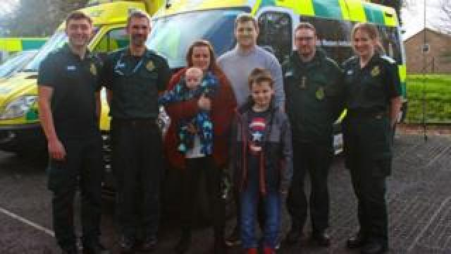Jayne Rowland and family visiting staff at the Taunton Ambulance Station