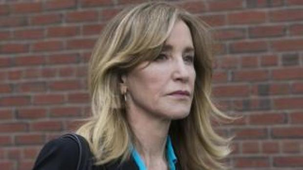 US actress Felicity Huffman leaves court in Boston, Massachusetts, on 3 April 2019