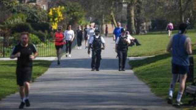 Police officers were seen walking through Greenwich Park in London