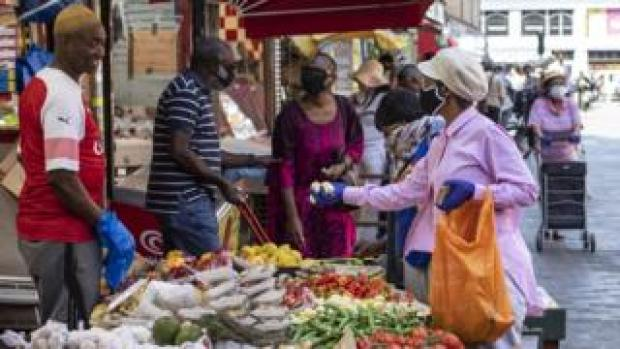 A fruit and vegetable stall trades at Brixton market