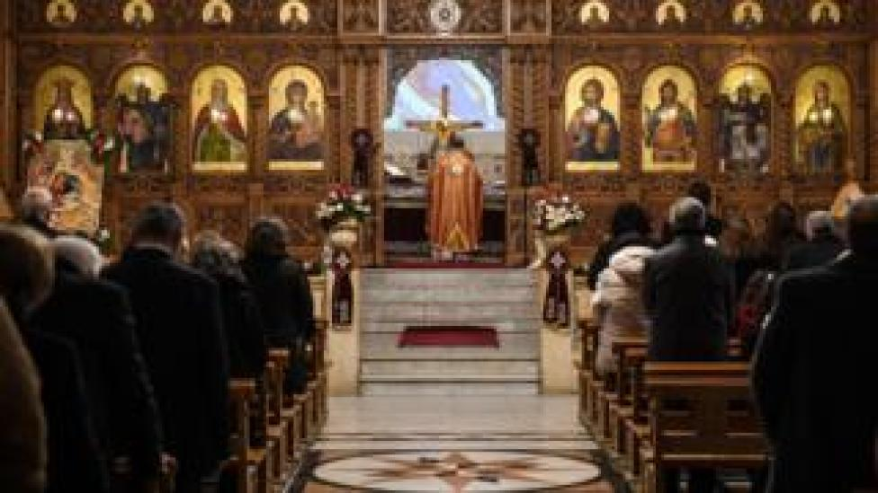 Worshippers attend Christmas Morning mass at a Syriac Orthodox Church in Syria