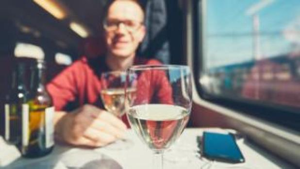 Man drinking wine on a train