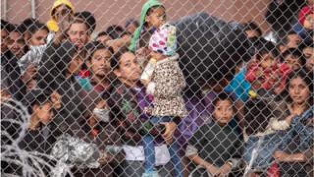 Migrants are gathered inside the fence of a makeshift detention center in El Paso, Texas on Wed. March 27, 2019