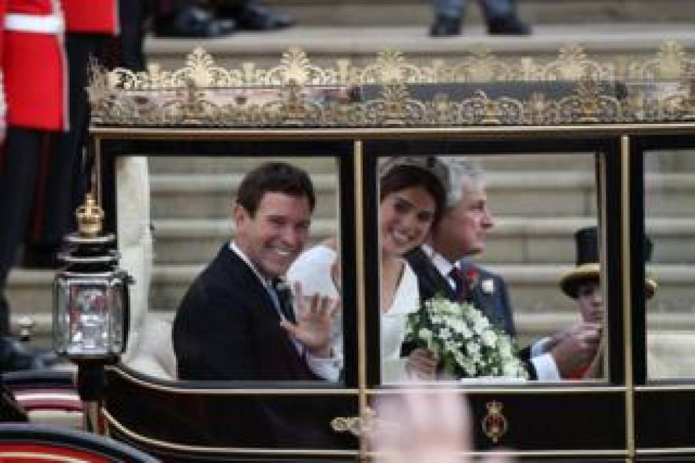 NEWS Princess Eugenie of York and her husband Jack Brooksbank walk down the West Steps of St Georg's Chapel