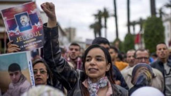 Moroccan protesters shout slogans during a protest
