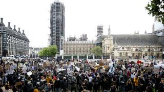 Protesters gather in Parliament Square, London
