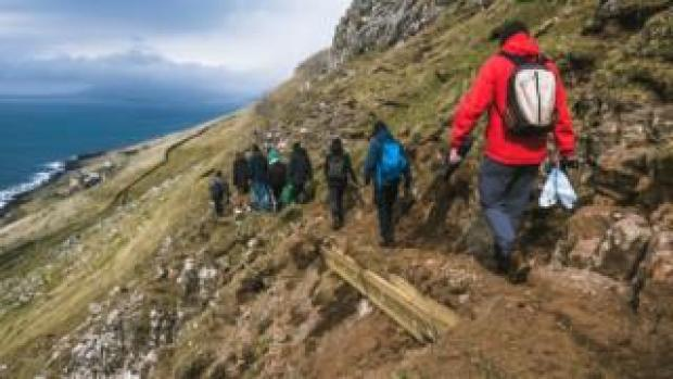 Green Group members walk past a strengthened pass