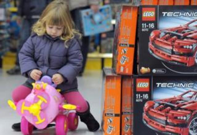 File pic of girl playing with toy in a store in France