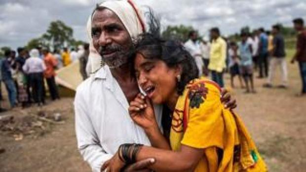 Man hugging a distressed woman