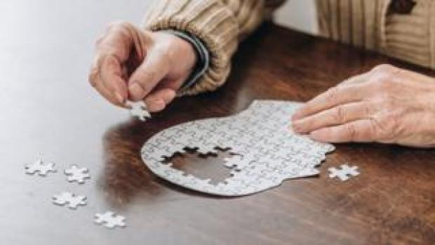 Man working on a brain jigsaw