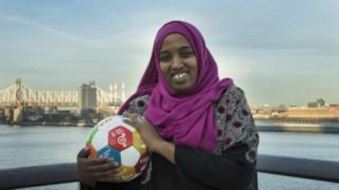 Fatuma Abdulkadir Adan standing with a football