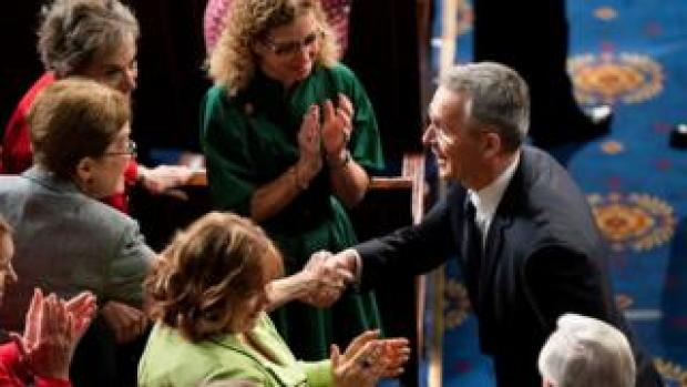 Jens Stoltenberg shakes hands with lawmakers before delivering an address to a joint meeting of the US Congress, 3 April
