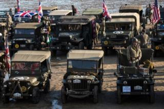 Period vehicles on the beach of Arromanches