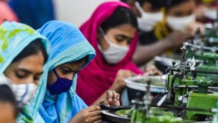 Workers work in a garment factory during a government-imposed lockdown as a preventive measure against the spread of the COVID-19 coronavirus.