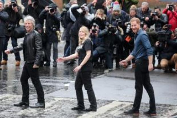 The Duke of Sussex, singer Jon Bon Jovi and Invictus Games representatives are seen on the iconic Abbey road crossing