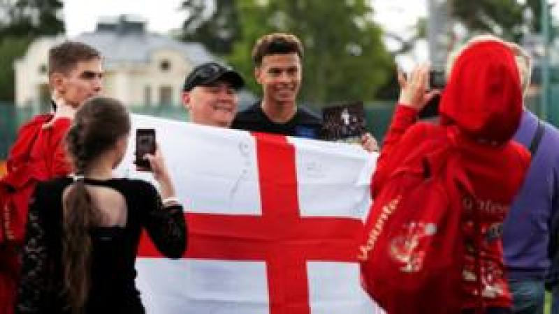 "England""s Dele Alli poses for a picture with fans during training in St Petersburg"