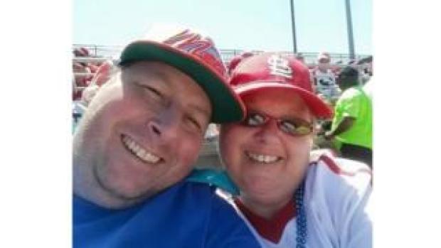 Man and woman at baseball game.