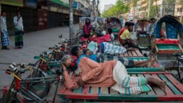 Day labors who are three wheeler pullers sleeping on their vans as there are no works due to partial lockdown to keep people safe from coronavirus (COVID-19) spread in Narayanganj, Bangladesh.