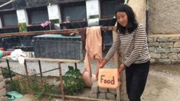 Padma Dolma shows food box