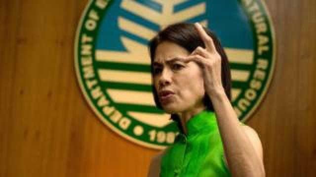 Gina Lopez gesturing during an interview in 2017