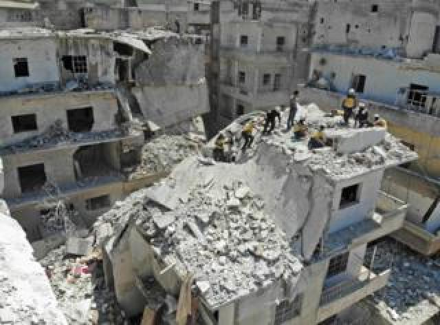 White helmets to try rescue someone from a damaged building in Idlib province
