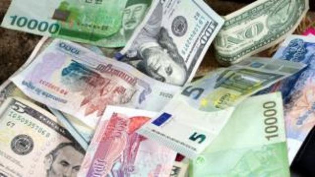 US dollars, Korean Won, Euro bills and some money bills and b