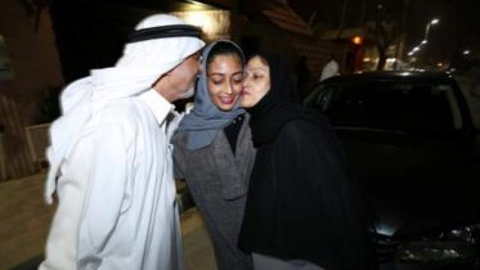 Hannan Iskandar is kissed by her parents, after she drove her car in her neighborhood, in Al Khobar, Saudi Arabia,