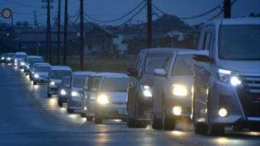 A traffic jam is seen as people evacuate after tsunami advisories were issued following an earthquake, in Iwaki