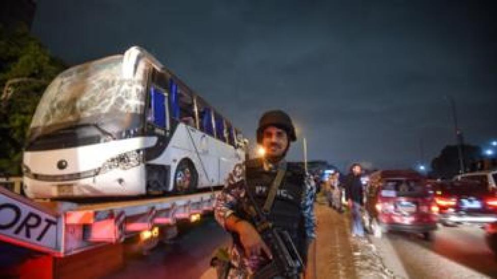 Image shows a tourist bus which was attacked being towed away from the scene, in Giza province south of the Egyptian capital Cairo.
