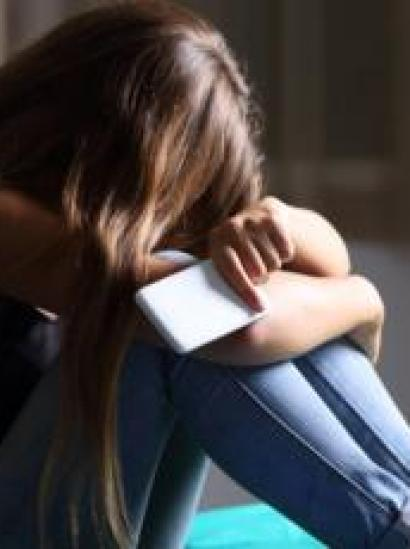A teenage girl with a smartphone