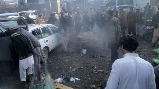 Pakistani security officals and local residents gather at the site of a bomb explosion at a vegetable market in Parachinar city, the capital of Kurram tribal district on the Afghan border on January 21, 2017.
