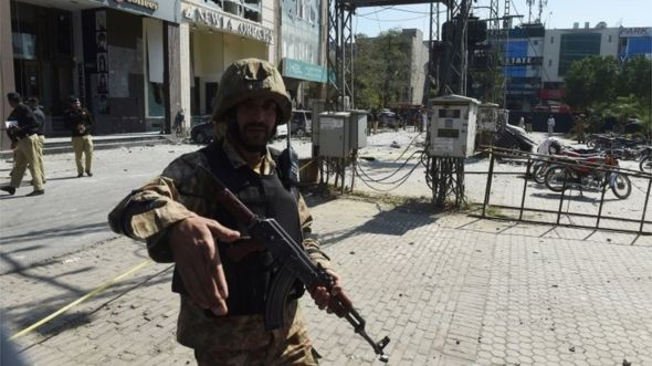A Pakistani soldier cordons off the site of a bomb attack in Lahore on February 23, 2017