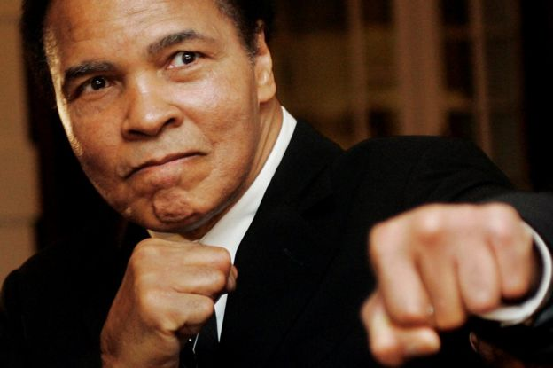 U.S. boxing great Muhammad Ali poses during the Crystal Award ceremony at the World Economic Forum (WEF) in Davos, Switzerland, in this January 28, 2006 file photo.