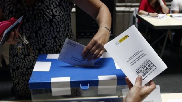 A woman casts her vote in Spain in 2014