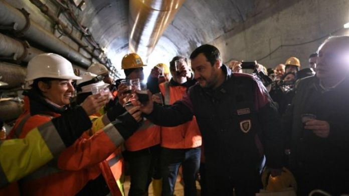 Matteo Salvini drinks wine with workers during a visit to the building site of the TAV high-speed train line between Italy and France, on February 1, 2019 in Chiomonte, north-western Italy