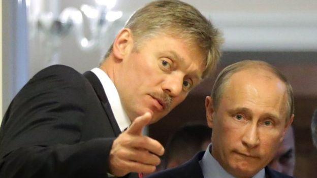 Dmitry Peskov with Vladimir Putin (R) - file pic