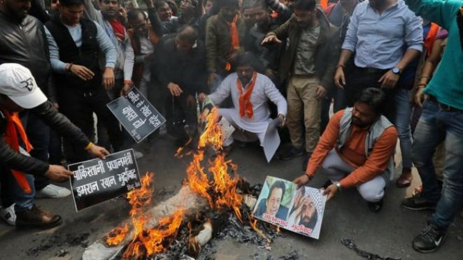 Right wing Hindus burn photos of Mr Azhar and Pakistani Prime Minister Imran Khan