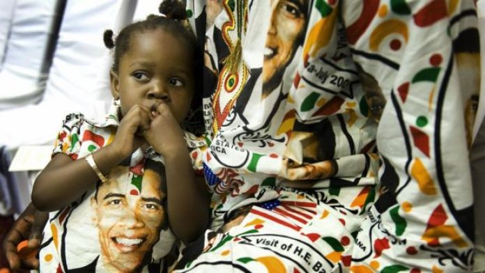 Two-year-old Princess Smith sits with her father Francis Smith on July 11, 2009 as they wait for US President Barack Obama's arrival at the International Conference Center in Accra, Ghana, where he is to address members of the parliament.