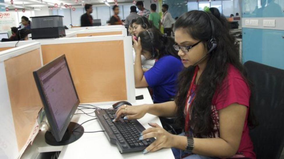 Young woman working at her desk at Oyo