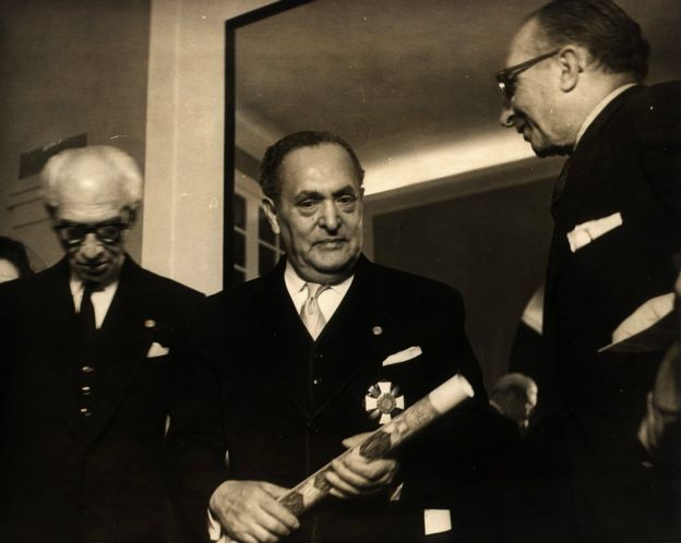 Gilberto Bosques receives a decoration for his work.