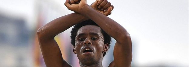 Ethiopia's Feyisa Lilesa crossed his arms above his head at the finish line of the Men's Marathon athletics event of the Rio 2016 Olympic Games