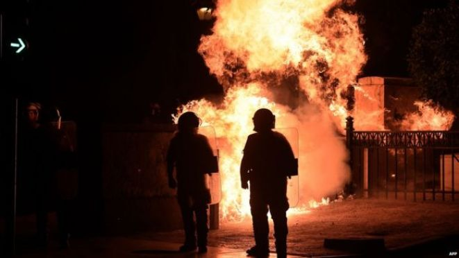 Fire bomb explodes near riot police in Athens on 22 July 2015