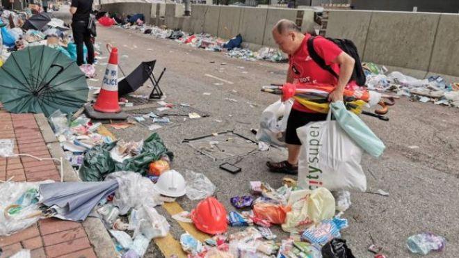 Man picking up trash