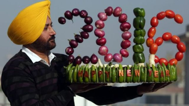 Indian artist Harwinder Singh Gill displays his new vegetable artwork made with vegetables on New Year
